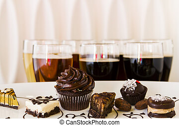 Tasting of beer and pattie chocolate pastries.