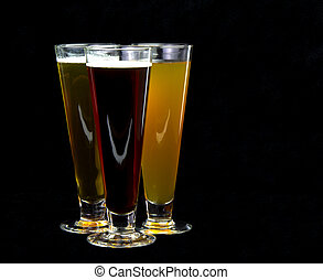 Beer and glasses - Dark, lite and amber beer shot under soft...
