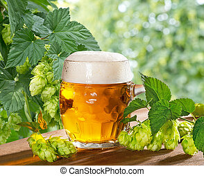 Beer and Hops - still life with beer glass and hops