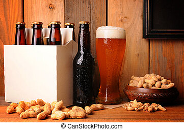 Beer and Peanuts in Rustic Setting - A glass of beer next to...