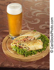 Beer and shawarma - Pint of beer and shawarma over wooden ...