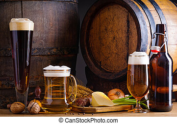 Cellar still life with beer, traditional food and barrels