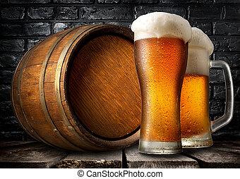 Beer and wooden keg near black brick wall