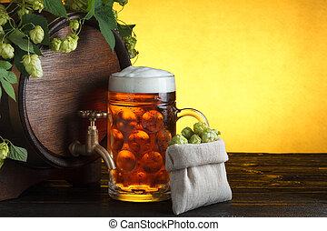 Beer barrel with fresh hop cones