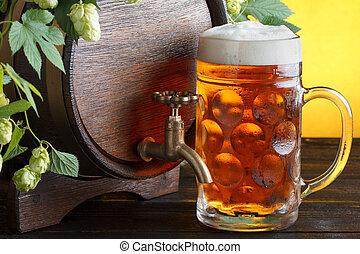 Beer barrel with fresh hops