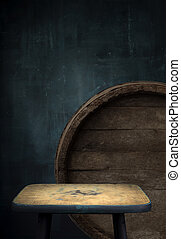 Beer barrel with glasses on table wooden background
