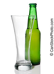Beer bottle and empty glass isolated on white