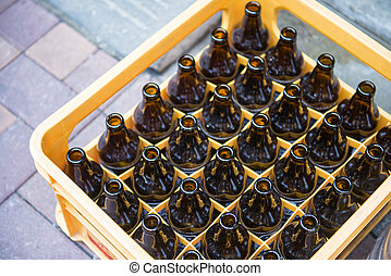 beer bottle in yellow plastic crates, glass