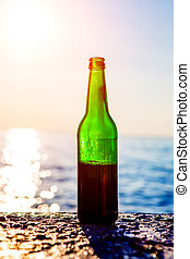 Beer Bottle outdoor - Bottle with a Dark Beer on the Sea...