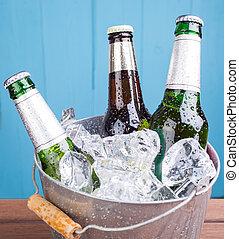 Beer bottles inside ice bucket