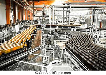 Beer bottles on the conveyor belt - Interior of a modern ...