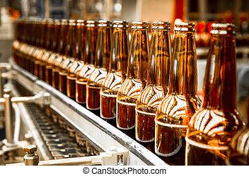 Beer bottles on the conveyor belt, brewery