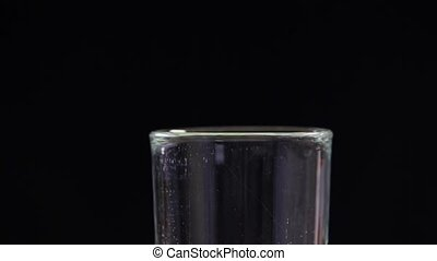 Beer Bubbles in to Glass - bubbles rising inside a glass of...