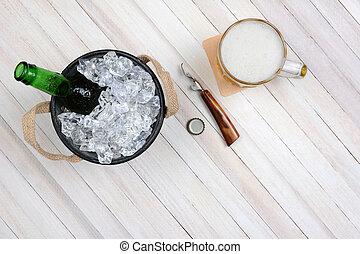 Beer Bucket Mug and Opener - Overhead shot of an ice bucket...