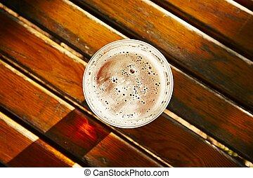 Beer - Cup of beer in garden restaurant