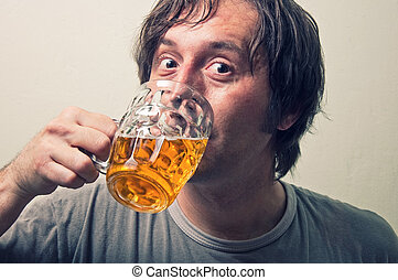 Portrait of an adult man drinking beer