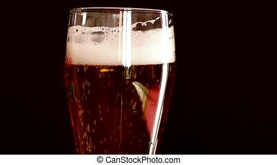 Beer Fizz an Foam - Detail of foam and fizz of a fresh full...