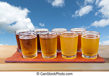 beer flight - Beer flight of eight sampling glasses of craft...
