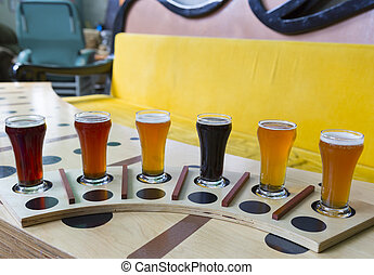 beer flight of six sampling mugs of light and dark craft beer