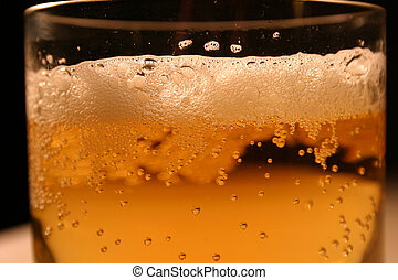 Beer foam - Beer in glass close-up.
