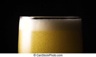 Beer foam in a glass slow mo super
