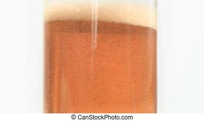 Beer foam turning in slow motion - Beer foam turning in...