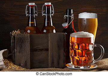 Beer glass and crate with beer