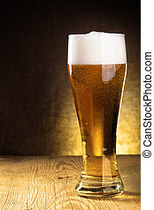 Beer glass - Single beer glass close-up on wooden table