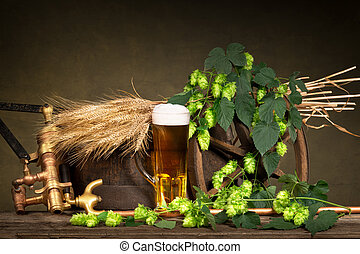 Beer Glass With Barley And Hop Cones - glass of beer with...
