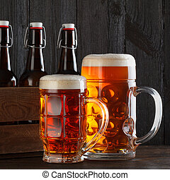 Beer glasses on table with crate