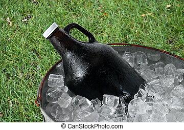 Beer Growler in Ice Bucket - A 64 ounce beer growler in a...