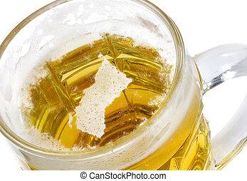 Beer head shaped as British Columbia in a beer mug.(series)