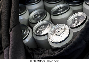 Beer in aluminum cans in a black travel bag. The concept of an integral attribute of picnic and lifestyle on vacation