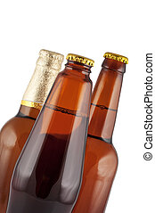 Beer in bottles close up isolated on white.