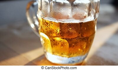 Beer in glass on a wooden table