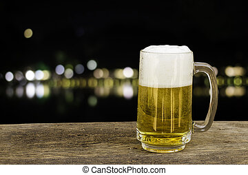 Beer in glass on background with bokeh