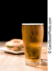 Beer in glass on black background
