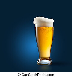 Beer in glass on blue