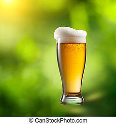 Beer in glass on natural background