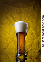 Beer in glass  on yellow background