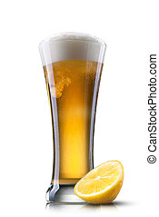 Beer in glass with lemon isolated on white background