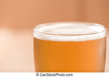 Beer in glass,on wood background