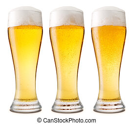 Beer into glass isolated on white.
