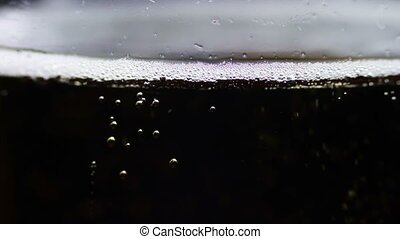 Beer is Poured in a Glass - Beer cup fills Close-up. It is...