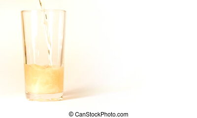 beer is poured into a glass on white background