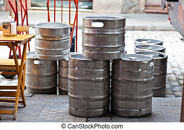 Beer kegs - In front of a guest house are empty beer barrels...