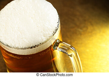 Beer mug with froth close-up on the wooden table