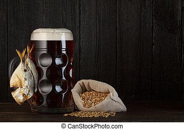 Beer mug with smoked salty fish