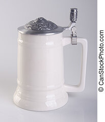 beer mug with traditional pewter cap on a background. - beer...