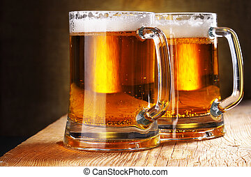 Beer mugs - Two beer mugs close-up on wooden table